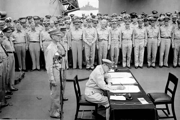 MacArthur signs Japanese Surrender