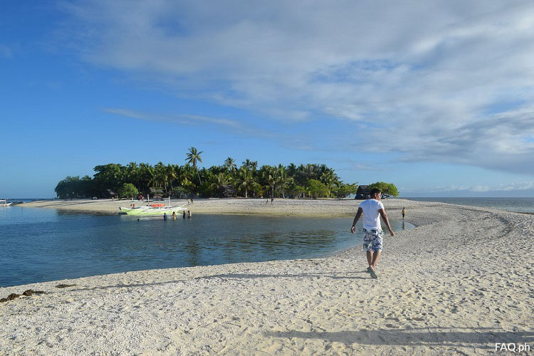 Walking on the sandbar Digyo Island